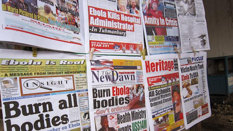 A close up of newspaper front pages focusing on the Ebola outbreak, including a newspaper, left, reading 'Burn all bodies' in the city of Monrovia, Liberia, Thursday, July 31, 2014. The worst recorded Ebola outbreak in history surpassed 700 deaths in West Africa as the World Health Organization on Thursday announced dozens of new fatalities. (AP Photo/Jonathan Paye-Layleh)