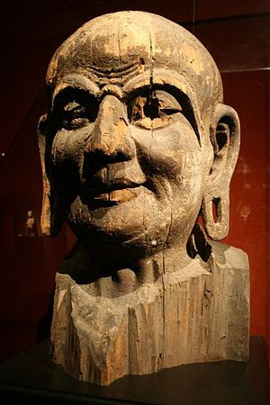 A Chinese sculpted wooden head representing Ka...