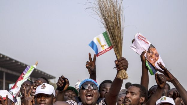 Supporters of the main Nigerian opposition All Progressive Congress (APC) party cheer as they attend a rally in Kaduna on January 19, 2015.