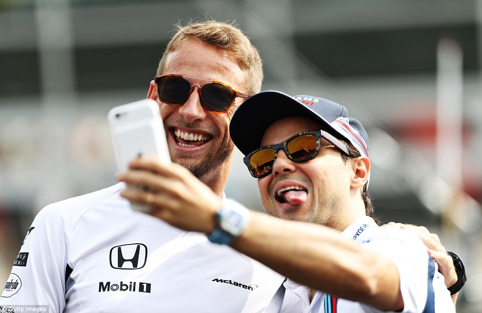 Jenson Button (left) and Felipe Massa pose for a selfie before the race with both drivers set to depart F1 at the end of the year
