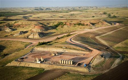 An aerial view of an oil well site near Watford City, North Dakota is seen in this picture taken May 17, 2012. Many North Dakota oil region residents receive $50,000 or $60,000 a month in oil royalties and some more than $100,000, said David Unkenholz, a senior trust officer at First International Bank & Trust in Watford City. Picture taken May 17, 2012. REUTERS/Ben Garvin