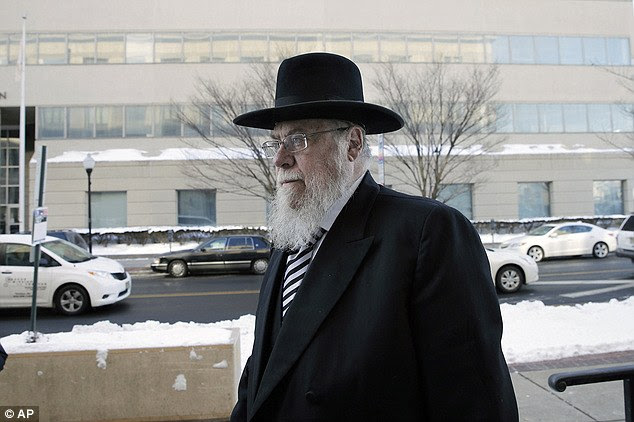 The well-known expert in Orthodox Jewish matrimonial law was convicted on April 21 after an eight-week trial on one count of conspiracy to commit kidnapping. He is pictured outside court in February