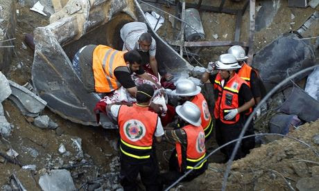 Rescuers remove the body of a member of the al-Najar family after a reported Israeli strike in Gaza