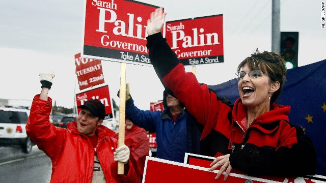Sarah Palin stands in the rain in Anchorage in August 2006 as she campaigns for the Republican gubernatorial nomination. Palin defeated incumbent Frank Murkowski and former state legislator John Binkley win the race.