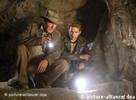 Harrison Ford playing Indiana Jones looking at a white light in front of him