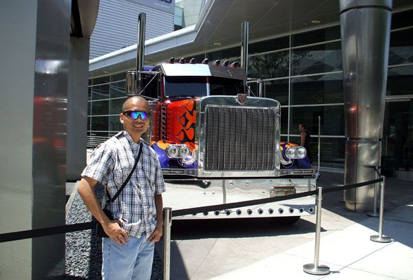 Posing in front of the Peterbilt truck that represents Optimus Prime in TRANSFORMERS: DARK OF THE MOON.