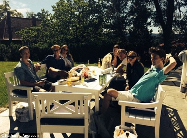 Group gathering: A group of the sisters' friends relax with beers in the sunshine. The siblings are among the youngest people in the world to have more than a billion dollars, according to Forbes