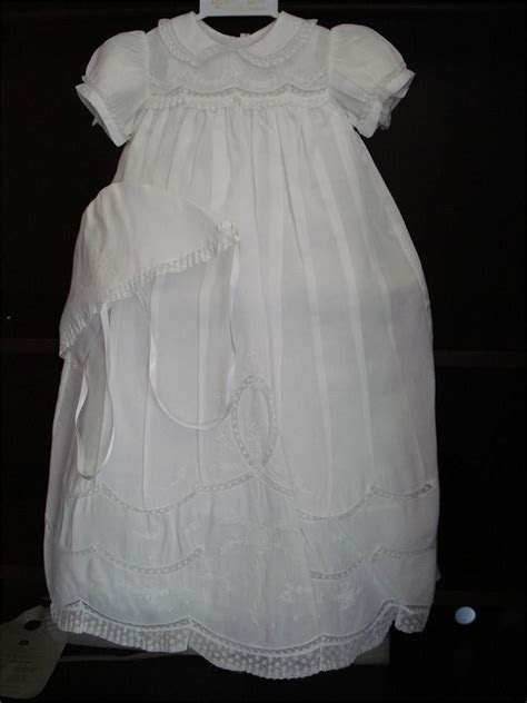 This is an elegantly, simple long Christening gown by