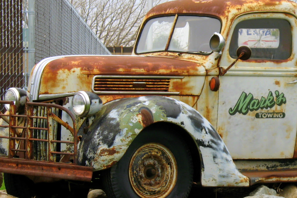 A very rusty tow truck.
