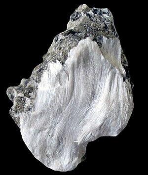 Asbestos (tremolite) silky fibres on muscovite...