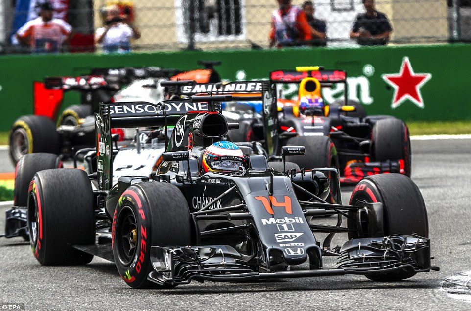 Fernando Alonso struggled to a 14th place finish for McLaren but picked up the fastest lap after pitting for a late tyre change