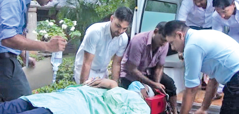 The injured doctor being taken to hospital. Picture by H.M. Ranjith Karunaweera