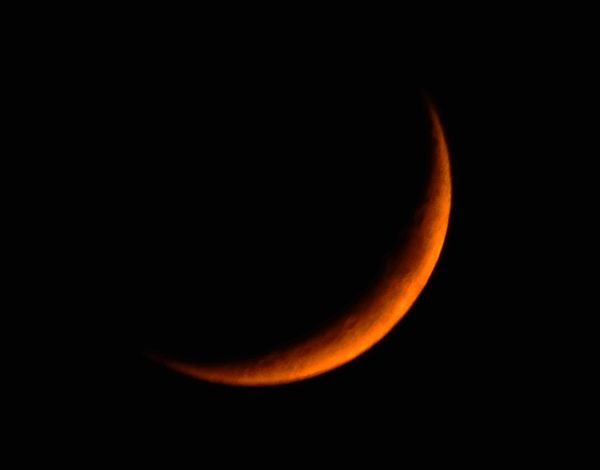 A snapshot I took of the Waxing Crescent Moon...which was tinted orange by smoke coming from the Woolsey Fire near Malibu, California, on November 10, 2018.