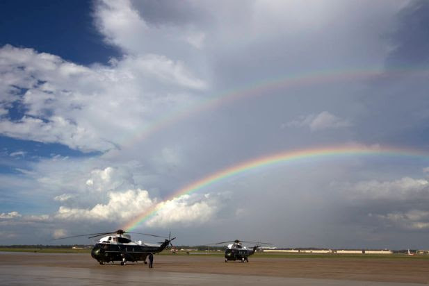 A rainbow appears over Marine One minutes before President Barack Obama landing at Andrews Air Force Base, Md., Monday, Sept. 1, 2014.