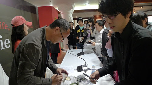 Johnnie To signing autographs