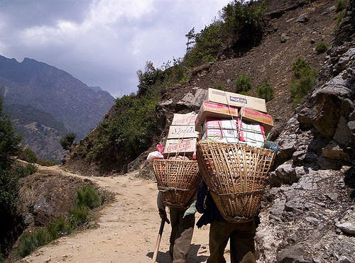Porters carrying back-breaking loads