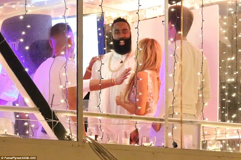 Photos from Khloe Kardashian  beau James Harden's yacht party + her thigh-high split dress.