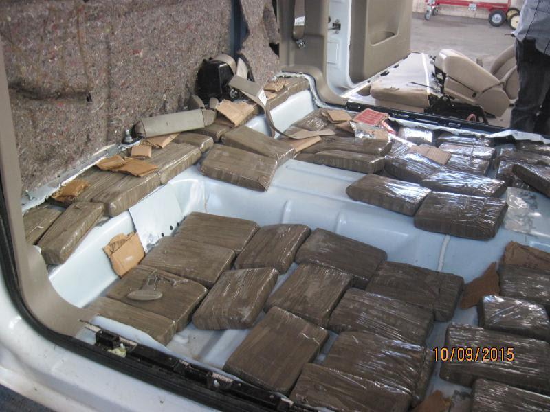 Drug bundles in floor of vehicle