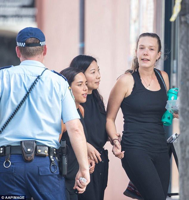 Bar staff were escorted from the building in Maroubra after the shooting on Friday (pictured)