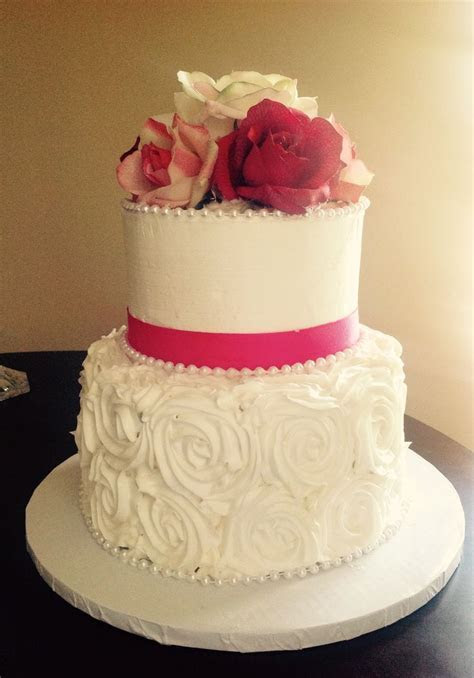2 tier white buttercream wedding cake with buttercream