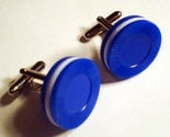 Blue and white poker chips on silver cufflinks in red gift box
