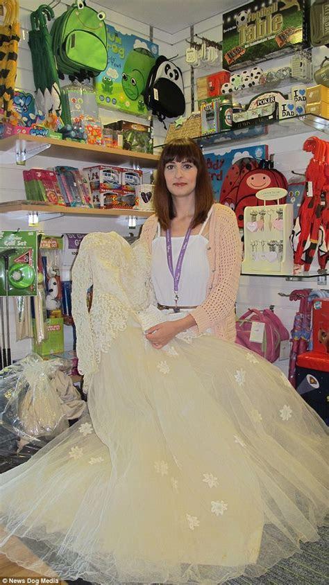Widower who gave late wife's wedding dress to charity shop