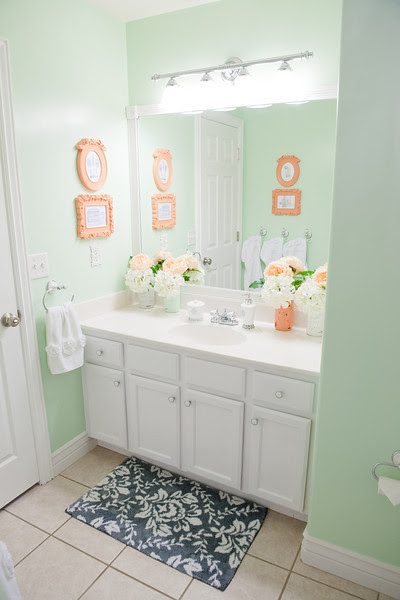 lovely coral colored bathroom | Lookie Loo Photography: Girls Mint & Coral Bathroom