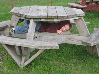 Nick hiding under a picnic table