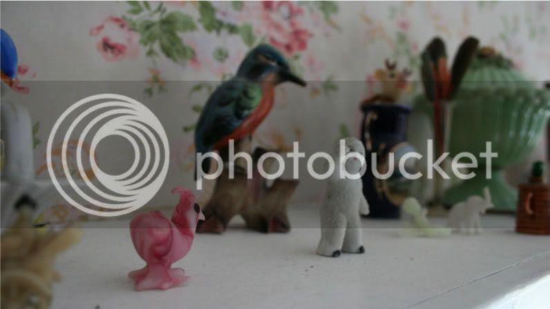 small vintage figurines on shelf