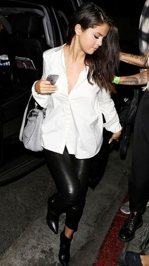 Le Fashion Blog Celebrity Style Selena Gomez White Button Down Shirt Black Leather Leggings Grey Bag Pointed Toe Ankle Boots Via WWW