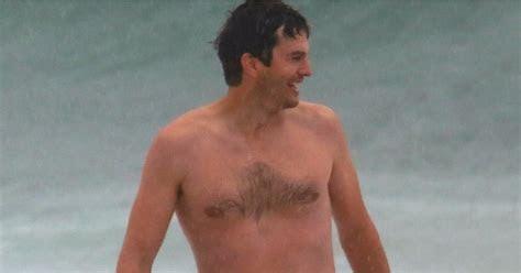 Ashton Kutcher Shirtless on the Beach in Brazil Oct. 2017