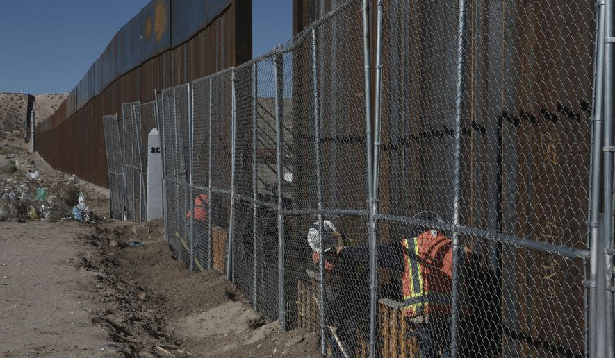 "Workers continue work raising a taller fence in the Mexico-US border separating the towns of Anapra, Mexico and Sunland Park, New Mexico, Wednesday, Jan. 25, 2017. U.S. President Donald Trump says his administration will be working in partnership in Mexico to improve safety and economic opportunity for both countries and will have ""close coordination"" with Mexico to address drug smuggling. It will set in motion the construction of his proposed border wall, a key promise from his 2016 campaign. (AP Photo/Christian Torres)"