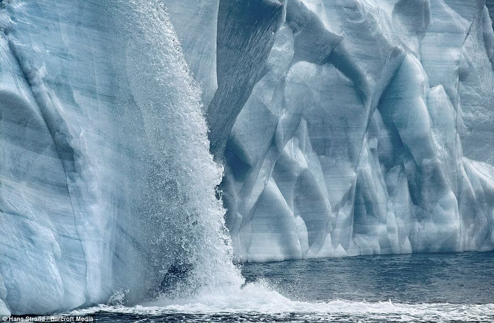 Hostile climate: The Austfonna glacier waterfall in Svalbard, Norway, crashes 160 feet into the ocean in this awe-inspiring image
