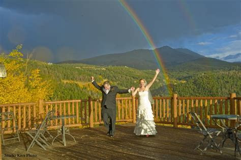 The Lodge at Breckenridge Bride and Groom with mountain