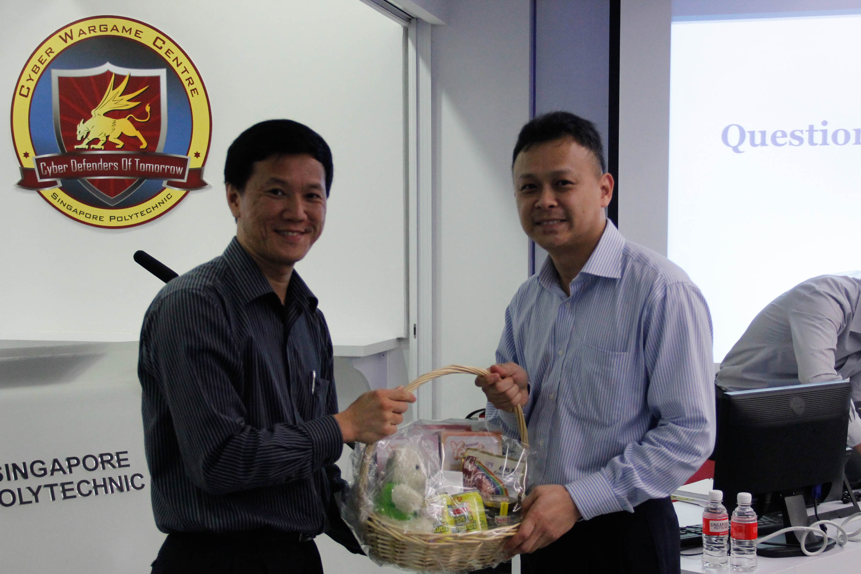 Mr Liew presenting a home-made SP gift hamper to Mr Ho