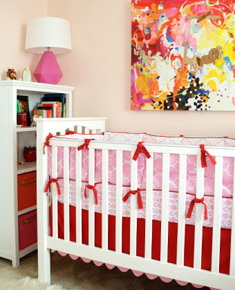 Bright, Warm Hues Pale pink, candy red, and hints of sorbet orange combine for a swirl of happy colors in this bright nursery space.