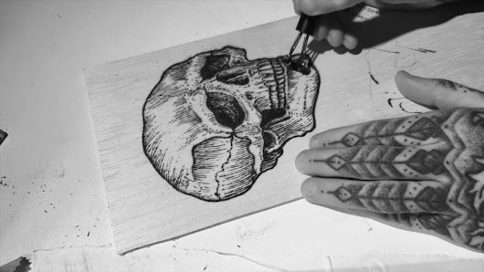 Watch this Tattoo Artist Burn a Skull
