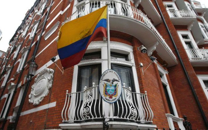 A national flag flies outside the Ecuadorian Embassy where Mr Assange is taking refuge