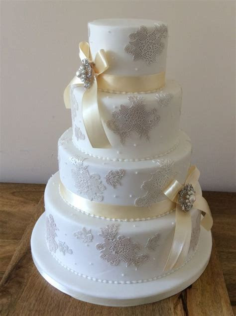 Edible lace accented four tier wedding cake   Beautiful