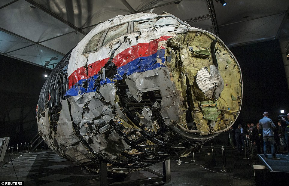 Crumpled: The reconstructed wreckage of MH17 is seen at the presentation of the final report into the crash