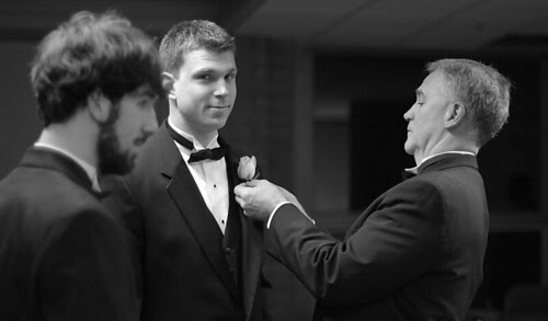 Father of the groom, pinning a boutonniere