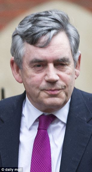 Former prime minister Gordon Brown seen leaving the Leveson inquiry in London