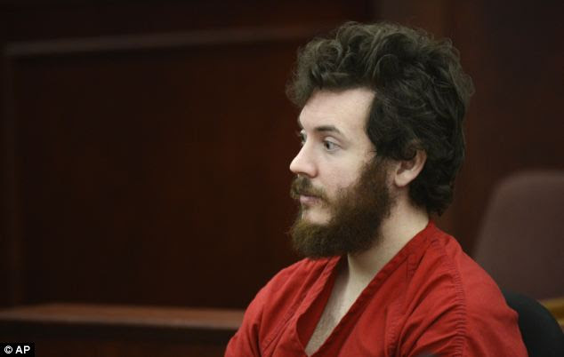 'Changed man': James Holmes, pictured in a Colorado courtroom during his arraignment on March 12, has reportedly turned Muslim in a bid to justify his horrendous killing spree