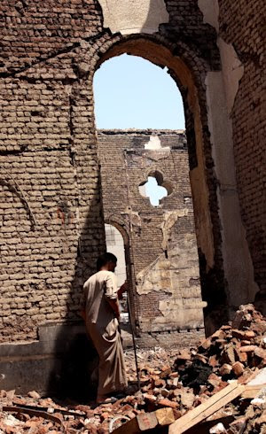An Egyptian walks in the ruins of the Evangelical Church …
