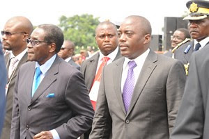 President Robert Mugabe of the Republic of Zimbabwe with President Joseph Kabila of the Democratic Republic of Congo. Mugabe was attending the inauguration of Kabila for another term in Kinshasha. by Pan-African News Wire File Photos