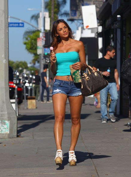 Sexy Model and Actress Melissa Riso enjoys a lollipop while strolling down Melrose Avenue in West Hollywood, California on May 29, 2013.