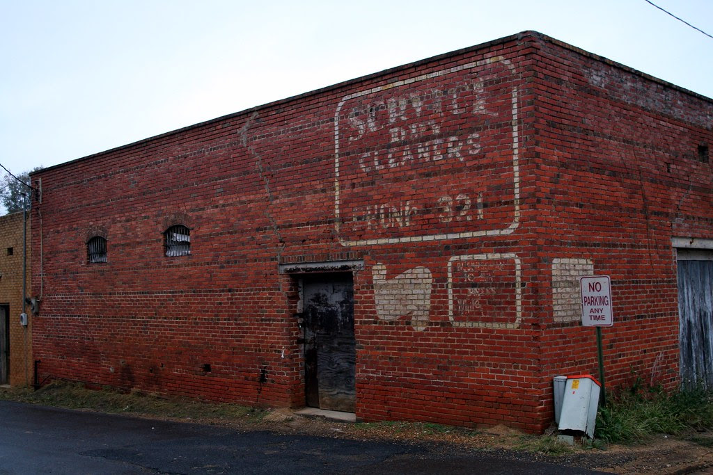 building with service dry cleaners ghost sign