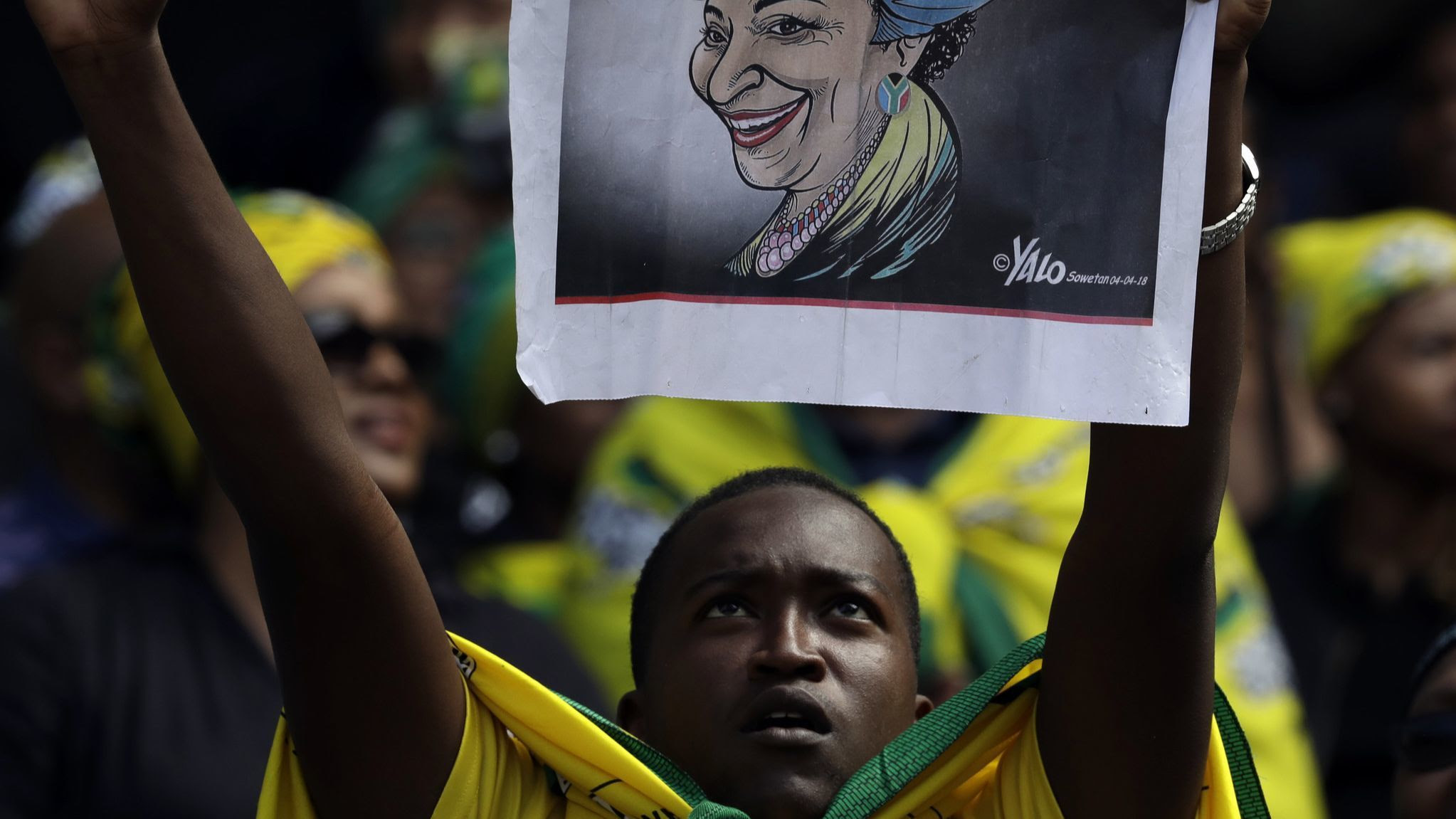 A mourner attends the funeral of struggle icon Winnie Madikizela-Mandela, at the Orlando Stadium in