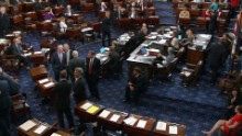"Senators talk on the floor of the US Senate before the vote on the ""skinny repeal"" on July 28."