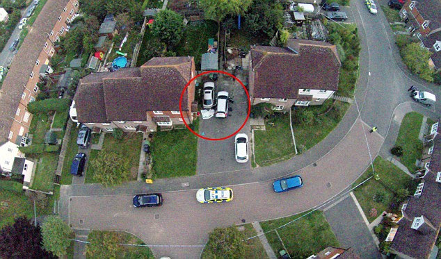 A girl has been shot in the quiet Sussex village of Northiam and there are reports her father killed himself after the incident. A blanket covering the man can be seen behind a car (pictured)